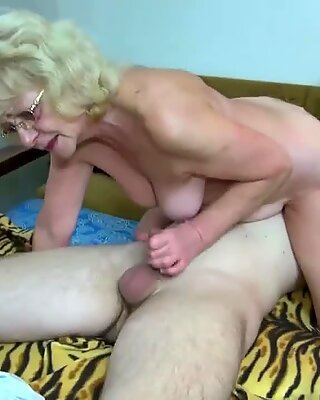 HOT youthful guy drilling grandma with strap-on