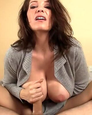 Busty milf babe tugging on hard cock
