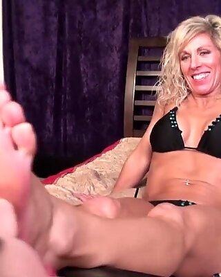 two youthful damsels lick older woman's feet