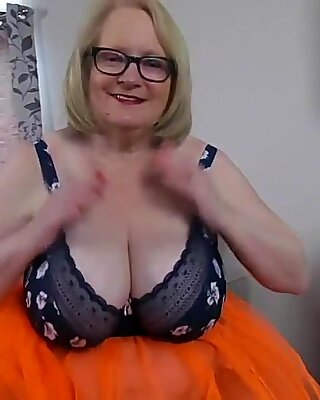 Busty Granny has a surprise under her orange skirt