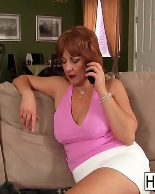 Hot redheaded MILF receives ejaculate to be with her massive tits
