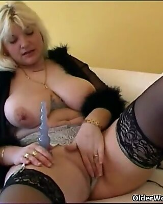 Chubby housewife in stockings plays with new sex toy