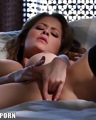 The beautiful vixen Emily Addison fingers herself to an amazing orgasm