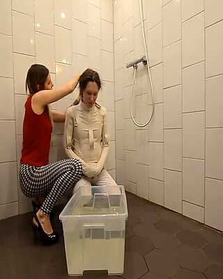 Water bondage in straitjacket and gas mask