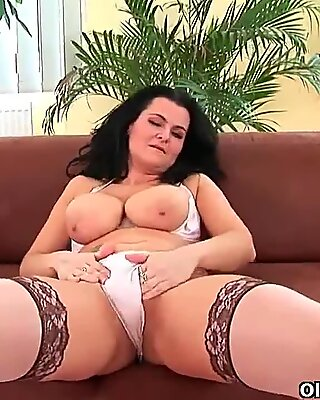 Soccer mom with big tits fucks a dildo