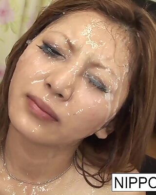 Gangbang beauty gets showered with cum