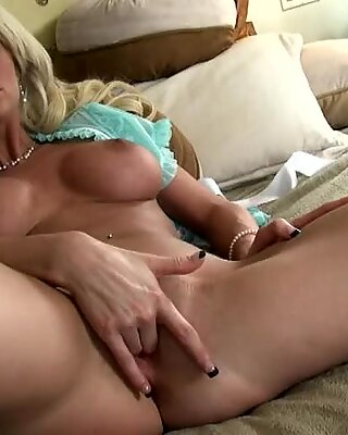 A horny hottie fingers her silky smooth wet cunt until she cums