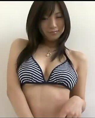 Milk skinned busty Asian Ren Yoshioka in her hot bikini suit