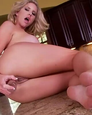 Shiny blonde MILF Ainsley Addison inserts whole banana in her quim