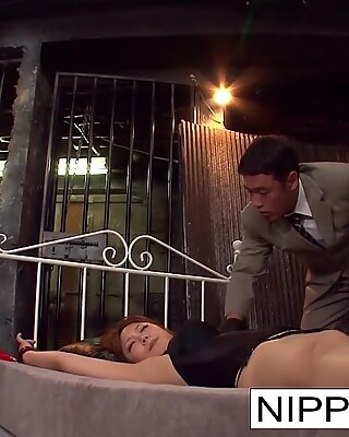 Tied up Asian hottie is fucked with fingers and toys