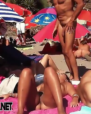Voyeur webcam catches amateurs nude and half nude on beach