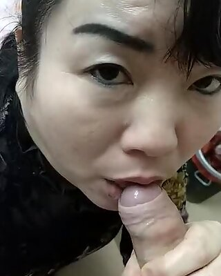 Chinese friend blows my cock, looking at the camera 1