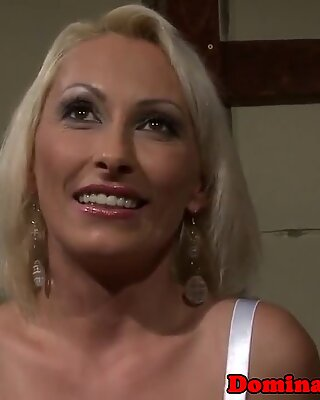 Mature beauty dominated in a dark dungeon