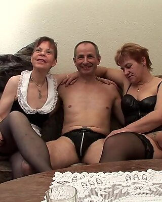Two grandmas play with a cock