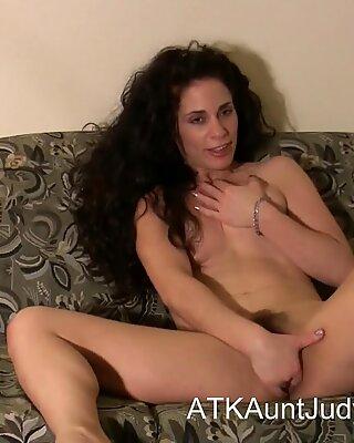 Morganna fingers and masturbates her way to orgasm.