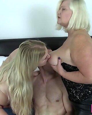 Granny in Brit threesome gobbles dick